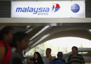 New Bermuda Triangle? People walk under a Malaysia Airlines sign at Kuala Lumpur International Airport in Sepang. Reuters