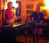 Alice Stewart and Tony Brannon on stage at The Swizzle Inn