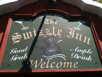 The sign over the door at The Swizzle Inn