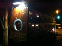 Swizzle Inn sign at night